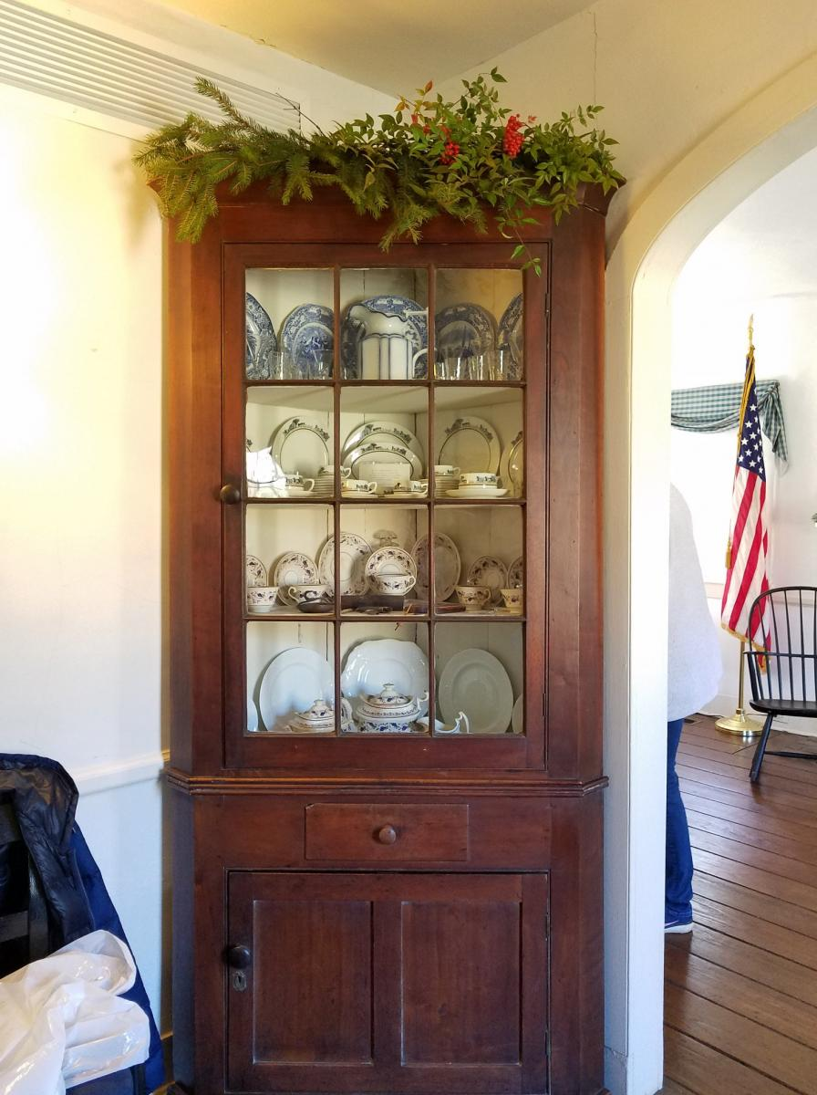 Curio cabinet with antiques